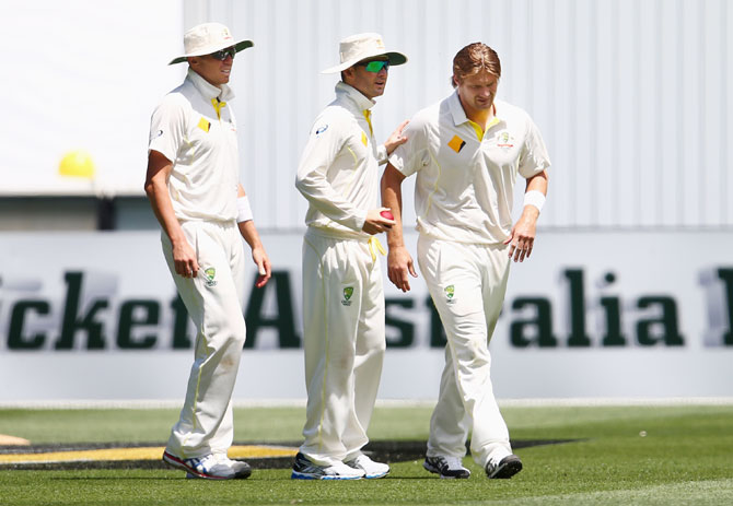 Shane Watson of Australia leaves the ground with a leg injury