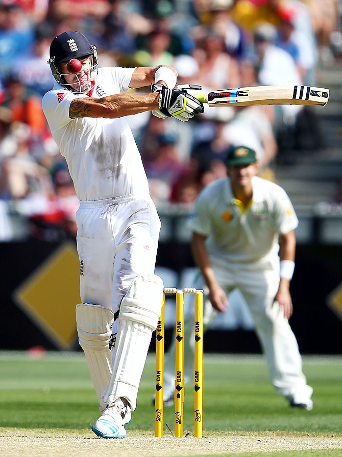 Kevin Pietersen of England is struck by a delivery from Peter Siddle of Australia on Day 1 of the fourth Test at the MCG on Thursday