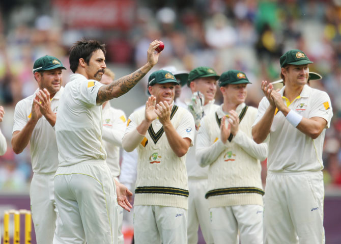 Mitchell Johnson acknowledges the crowd after taking five wickets during day two of the fourth Ashes Test