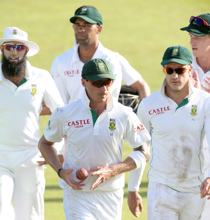 Dale Steyn of South Africa walks off with the match ball after his 22nd five-wicket haul during Day 2 of the 2nd Test match between South Africa and India