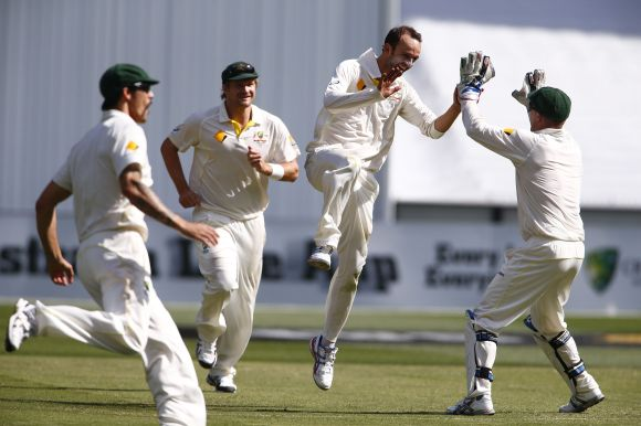 Nathan Lyon celebrates after picking up a wicket