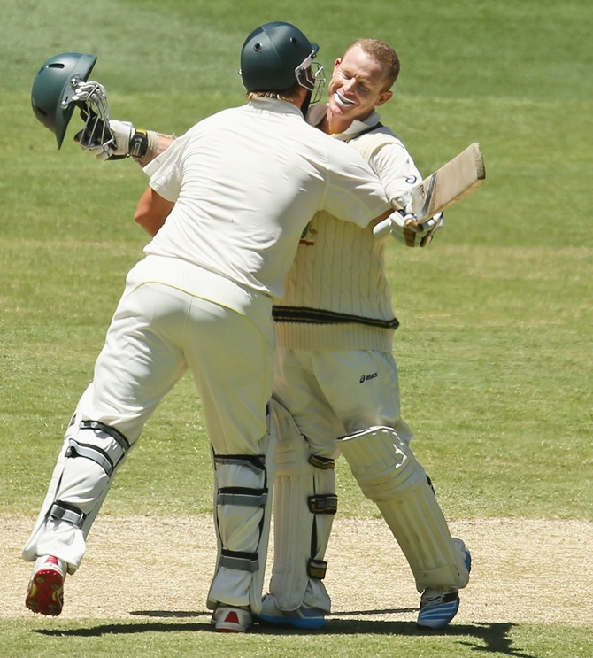 Chris Rogers of Australia is congratulated by Shane Watson of Australia after reaching his century