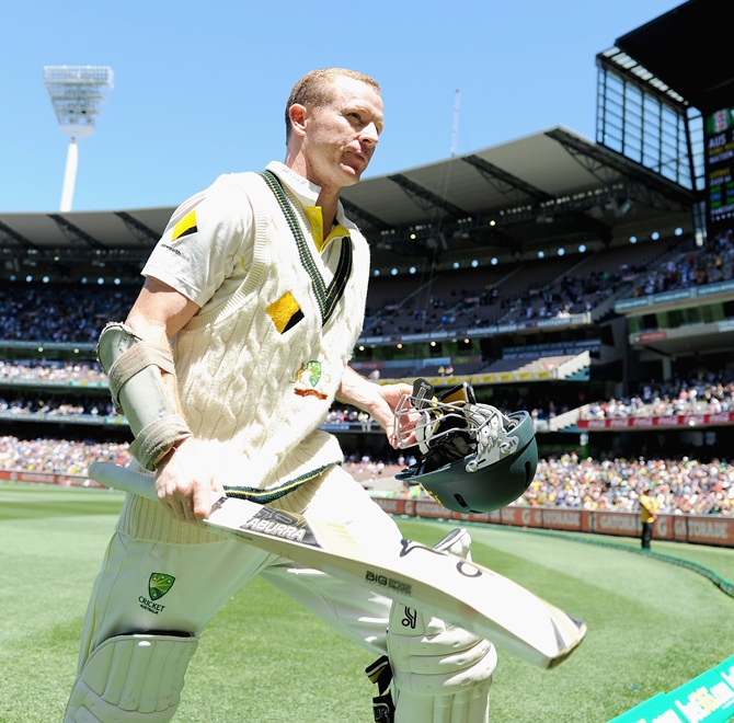 Chris Rogers of Australia leaves the field after making 116 runs