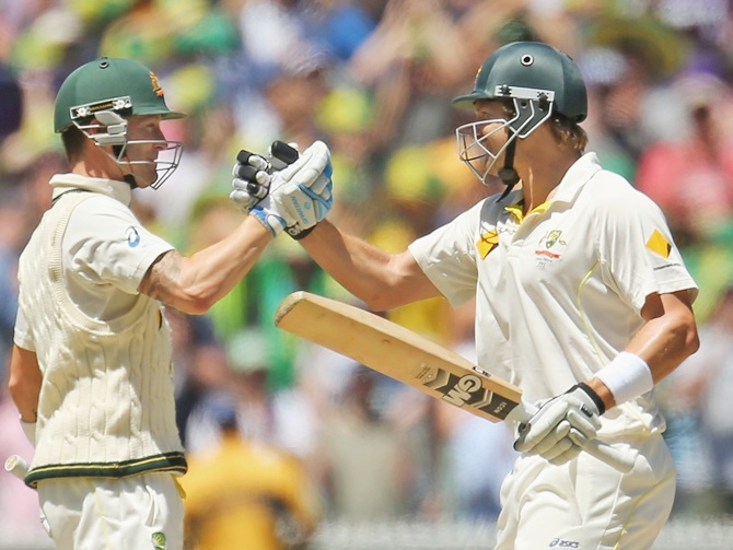 Michael Clarke (left) and Shane Watson of Australia embrace as Australia win the match