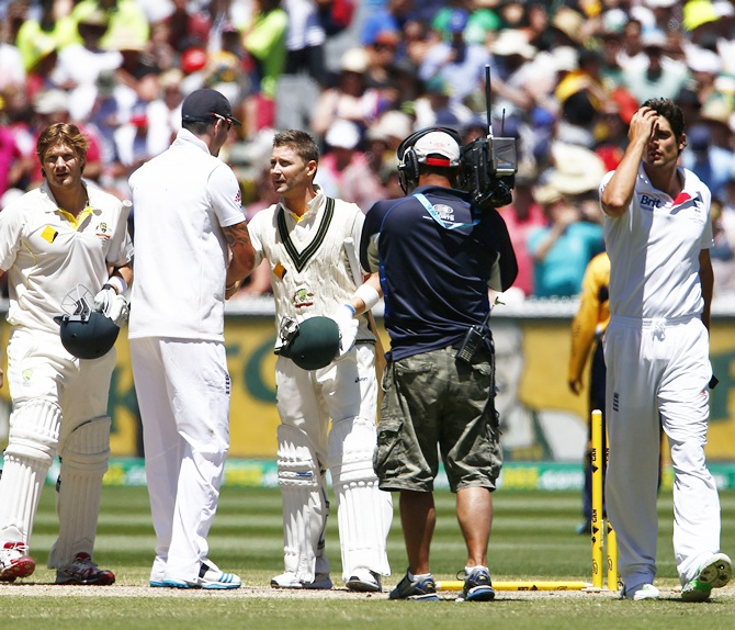 England's captain Alastair Cook (right) reacts as Australia's captain Michael Clarke (third right) shakes hands with England's Kevin Pietersen (third left), after England lost their fourth Ashes Test