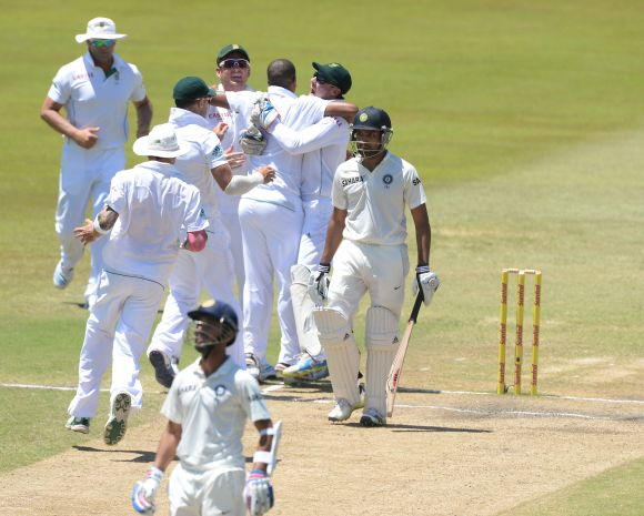 South African players celebrate after dismissing Rohit Sharma
