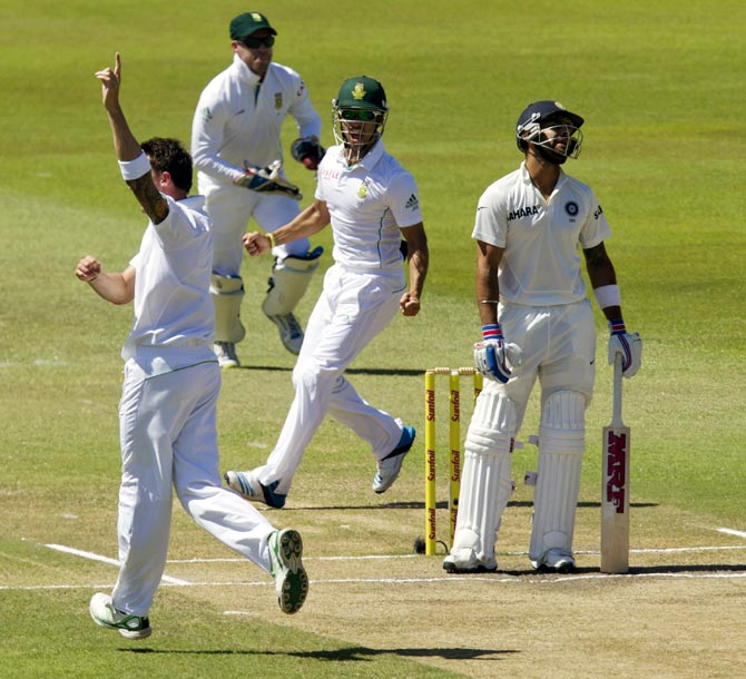 Dale Steyn (left) celebrates as Virat Kohli reacts after his dismissal