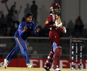 Niranjana celebrates after picking up the wicket of Deandra Dottin