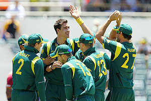 Mitchell Starc is congratulated by team-mates after bowling Kieron Pollard of the West Indies during the first game of the Commonwealth Bank ODI series at WACA on Friday