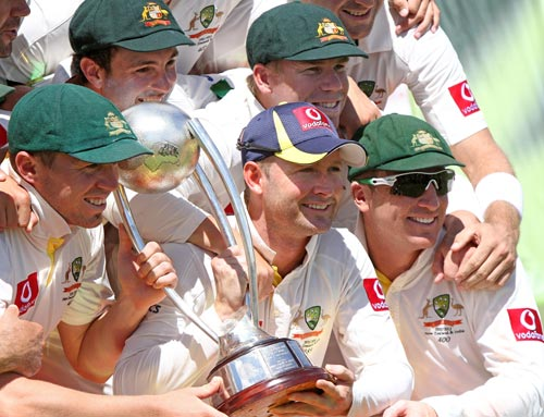 Australian players hold the Border-Gavaskar Trophy