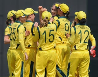 The Australian women's cricket team celebrate a wicket