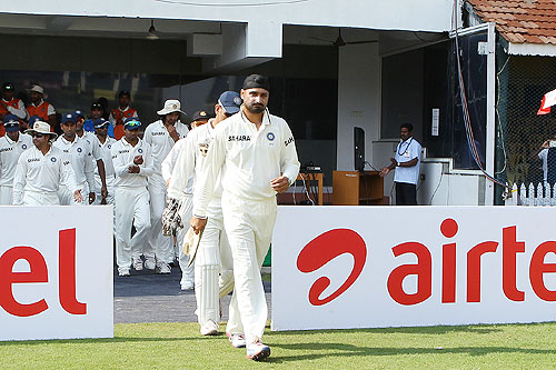 Harbhajan Singh leads out the team on his 100th Test appearance on Day 1 of the 1st Test between India and Australia at the MA Chidambaram Stadium in Chennai on Friday