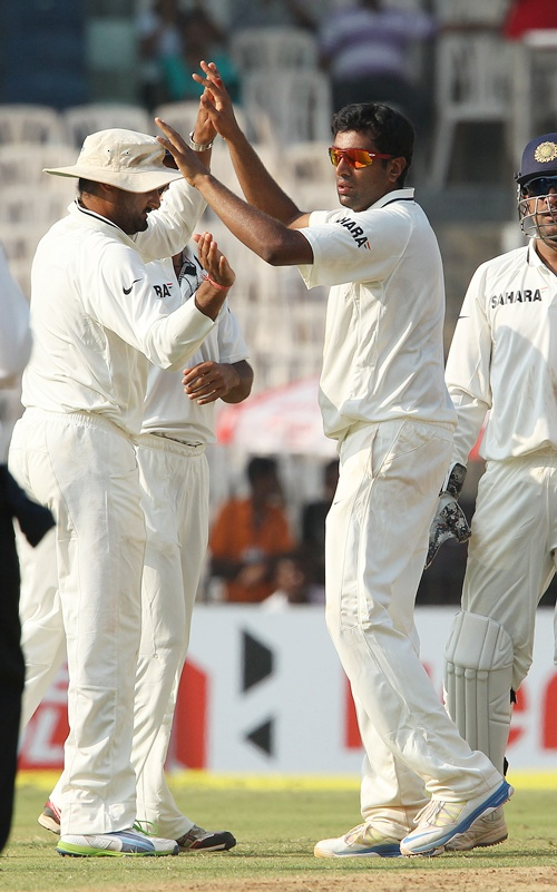 Ravichandran Ashwin of India celebrates the wicket of Moises Henriques