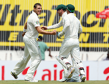 Australia's James Pattinson (left) celebrates the wicket of India's Virender Sehwag on Day 2 of the 1st Test at the MA Chidambaram Stadium in Chennai on Saturday