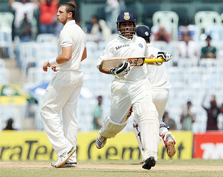 India's Sachin Tendulkar runs past James Pattinson on Day 2 of the 1st Test at the MA Chidambaram Stadium in Chennai on Saturday