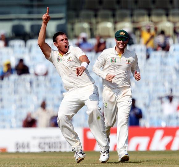 James Pattinson celebrates getting the wicket of Cheteshwar Pujara as captain Michael Clarke looks on