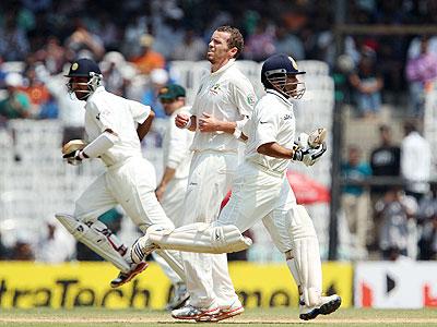 Australia's Peter Siddle looks on as India's Cheteshwar Pujara and Sachin Tendulkar steal a run on Day 2 of the 1st Test at the MA Chidambaram Stadium in Chennai on Saturday