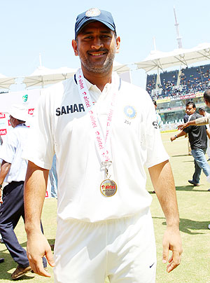 MS Dhoni shows off his Man of the Match medal on Tuesday