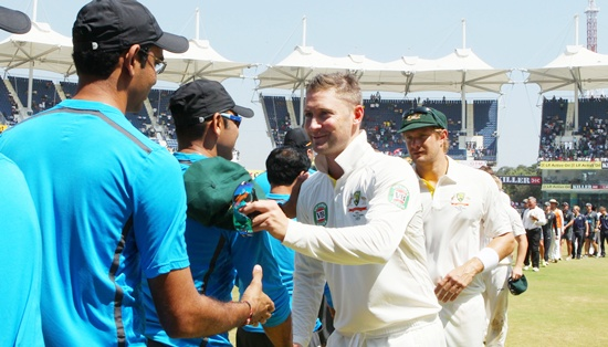 Michael Clarke congratulates the Indian players after the match