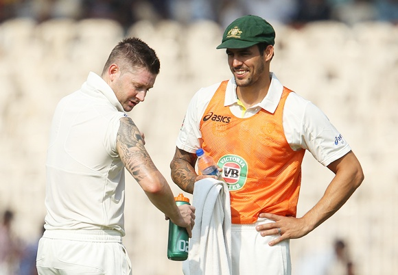 Michael Clarke and Mitchell Johnson chat during a drinks break