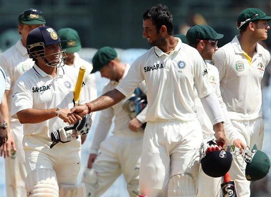 Sachin Tendulkar and Cheteshwar Pujara celebrate after India's win