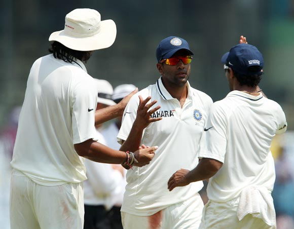 Ravichandran Ashwin, centre, celebrates with teammates.