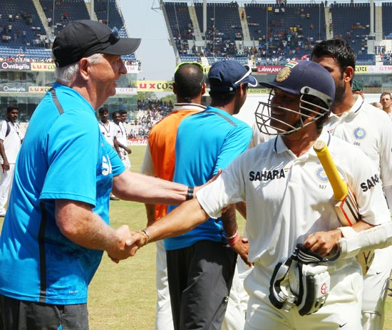 Sachin Tendulkar is congratulated by coach Duncan Fletcher