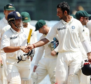 Tendulkar and Pujara greet each ohter after India's victory