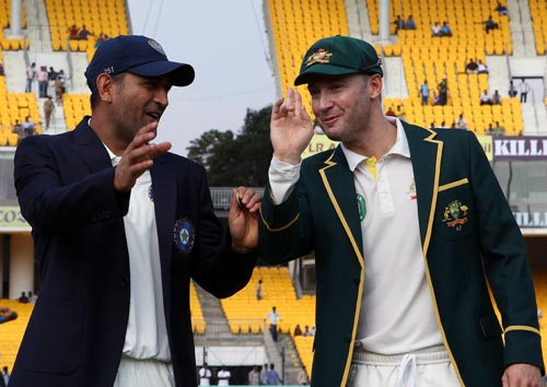 Mahendra Singh Dhoni chats to his Australian counterpart Michael Clarke