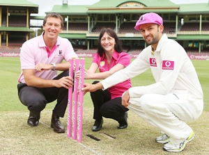 Glenn McGrath, McGrath Breast Care nurse, Karen Miles and Nathan Lyon of Australia pose
