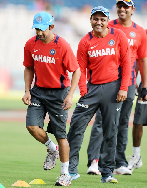 Virender Sehwag of India with teammates during a practice session