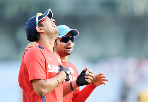 Yuvraj Singh of India shares a lighter moment with teammate Virat Kohli