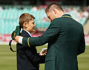 Australian captain Michael Clarke is presented with the handkerchief of the late Tony Greig by his son Tom Greig on Day 1 of the third Test between Australia and Sri Lanka at Sydney Cricket Ground on Thursday