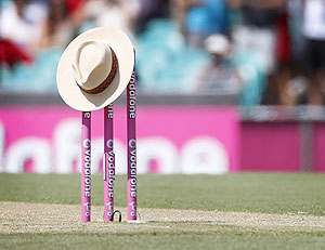 A hat, of the type often worn by Tony Greig, sits atop the stumps before the start of the first day's play of the third Test match between Australia and Sri Lanka