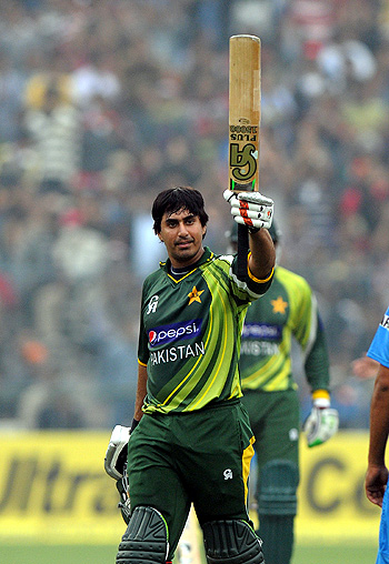 Nasir Jamshed raises his bat after scoring a second successive hundred