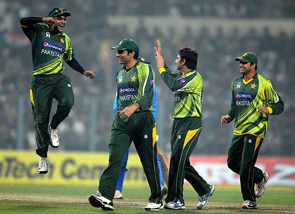Pakistan players celebrate after winning the match