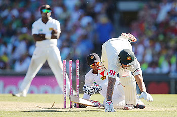 Mitchell Johnson collides with Dinesh Chandimal of Sri Lanka during day two of the Third Test match between Australia and Sri Lanka at Sydney Cricket Ground on Friday