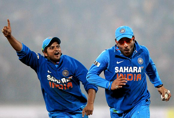Yuvraj Singh (right) and Suresh Raina celebrate India's victory