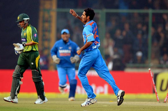 Bhuvneshwar Kumar is jubilant after taking the wicket of Younis Khan