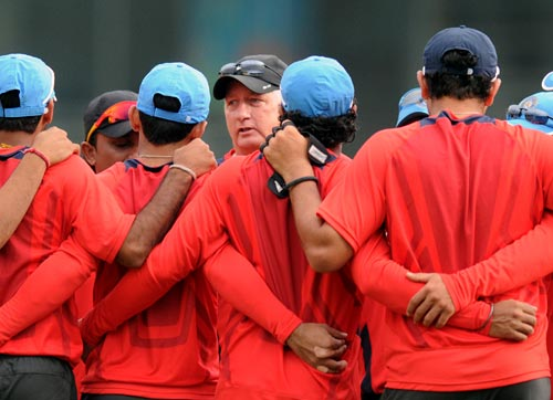 India coach Duncan Fletcher speaks to his team during a practice session