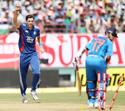 Steve Finn celebrates the wicket of Ajinkya Rahane