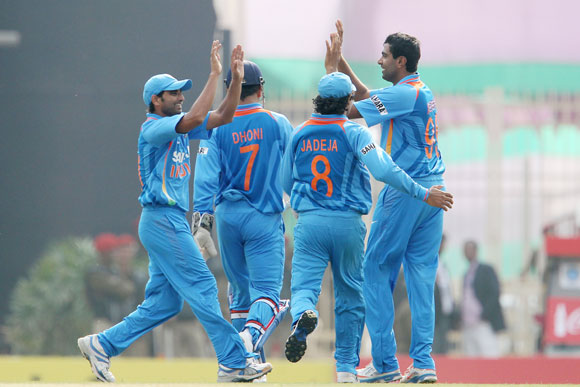 Ravichandran Ashwin of India celebrates the wicket of Eoin Morgan of England