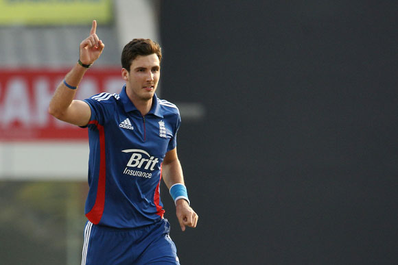 Steve Finn of England celebrates the wicket of Ajinkya Rahane of India