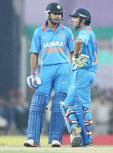 Virat Kohli of India and Gautam Gambhir of India chat in the middle