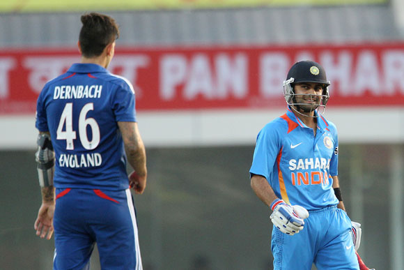 Virat Kohli of India is all smiles after top edging the ball for four from a delivery by Jade Dernbach of England
