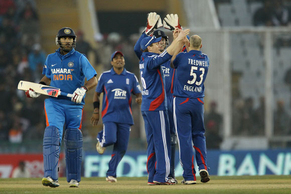 James Tredwell of England celebrates the wicket of Yuvraj Singh of India during the 4th ODI in Mohali
