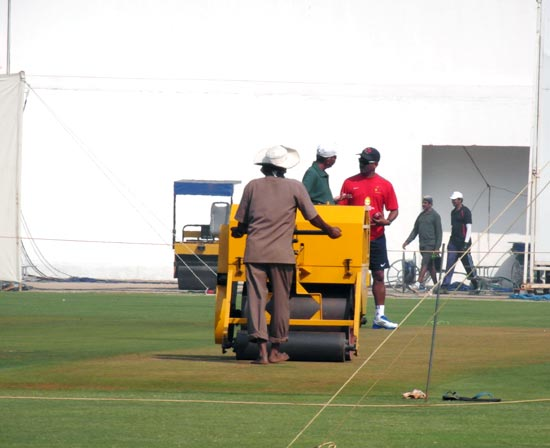 Mumbai coach Sulakshan Kulkarni has a close look at the Wankhede pitch