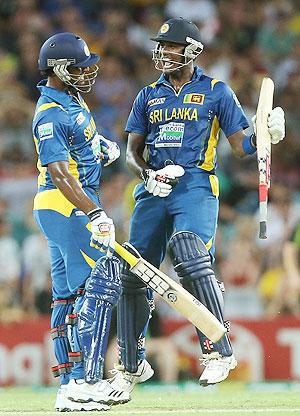 Thisara Perera and Angelo Mathews of Sri Lanka celebrate after winning the first Twenty20 international against Australia on Saturday