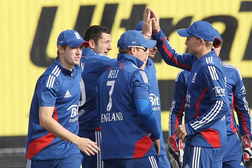 England celebrate the wicket of Rohit Sharma