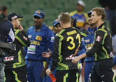 Matthew Wade, David Warner and George Bailey speak with the Sri Lankans as they leave the field